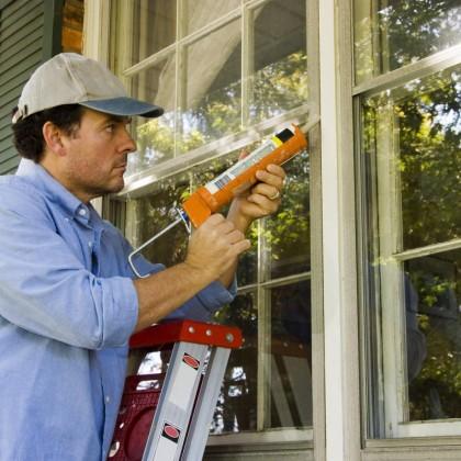 bigstock-Man-Caulking-Window-6193157